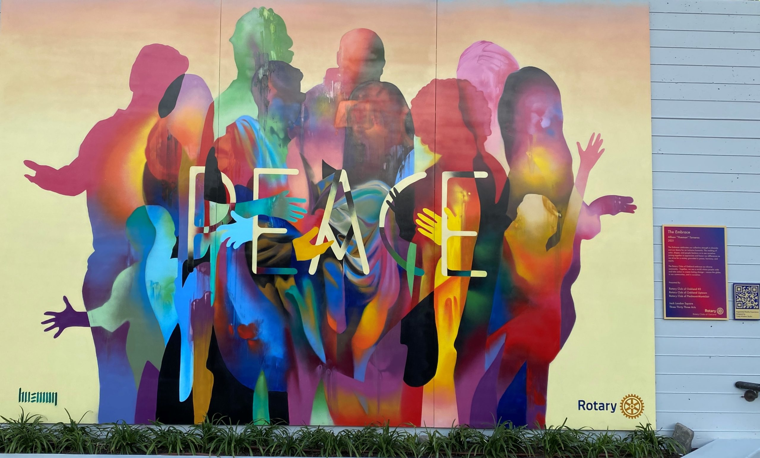 The Embrace Peace Mural by Hueman in Jack London Square